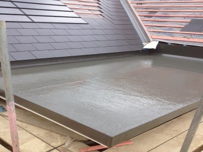 Fibreglass roof finishing to tiles.