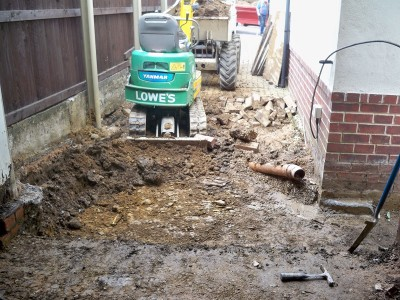 Start of digging out the existing drive ready for drains and concrete floor.