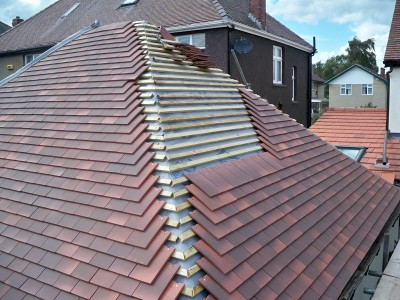 Roofing in Sheffield. New roof tiles being installed. Installation included a dry verge and hip system which is maintenance free.
