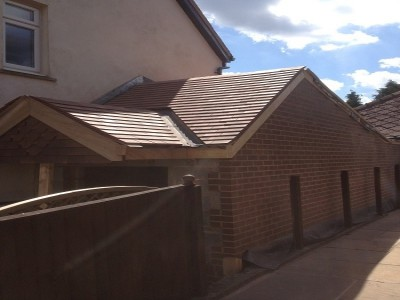 Completed roof and external walls of extension. Doors and internals to finish.