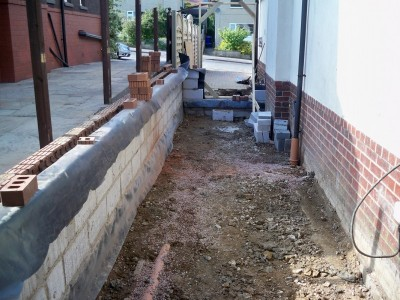 First courses of block work for new external wall of extension.